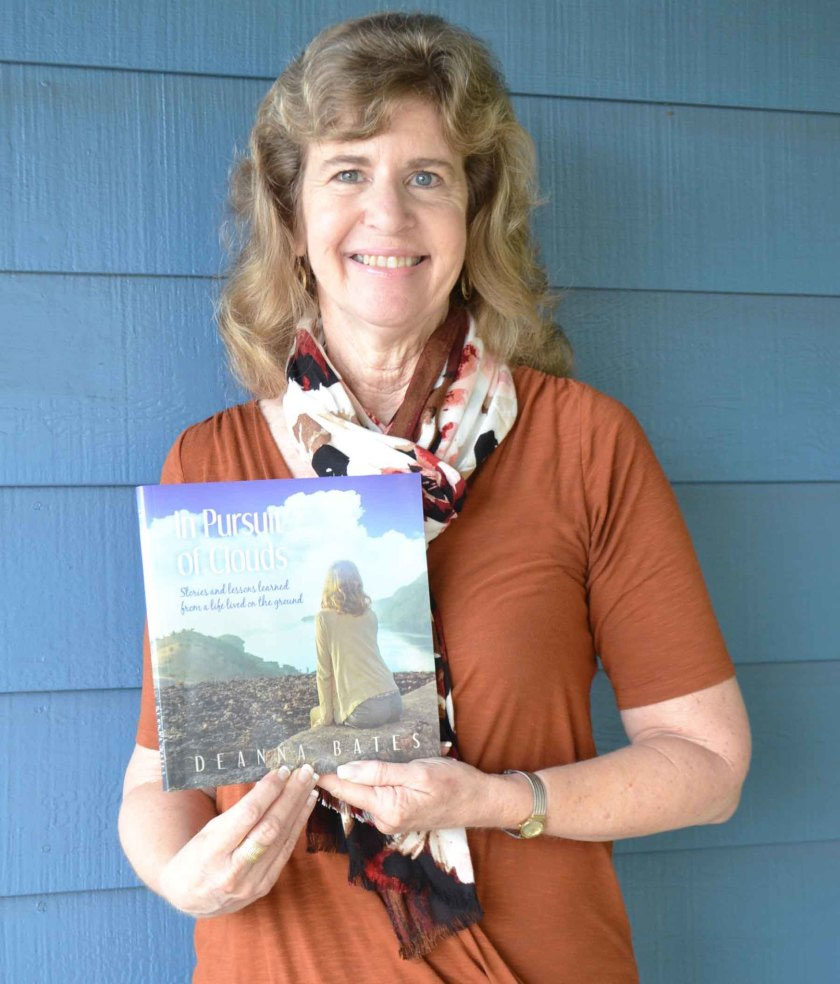 Deanna Bates holding her book